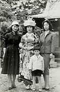 traditional dressed bride posing with friends Japan 1950s