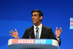 © Licensed to London News Pictures. 04/10/2021. Manchester, UK.  Chancellor Rishi Sunak speaks at the Conservative Party Conference on Monday. The annual Conservative Party Conference has returned to Manchester this year after being held online in 2020. Photo credit: Adam Vaughan/LNP