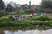 United Nations Park, a slum settlement in Paurakhi Basti, next to the Bagmati River in the centre of Kathmandu, Nepal.  The shacks are built with scrap plastic and wood.  The settlement has poor security and lacks in clean water, electricity, sanitation and other basic services.
