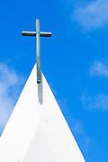 The crucifix atop St. Augustine Church in Waikiki, Oahu, Hawaii.