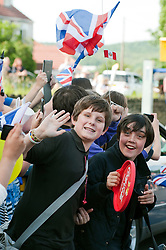 Olympic Torch reaches Sheffield Chapeltown/Ecclesfield/Parson Cross leg.<br /> Local school children cheer on the torch bearer on Ecclesfield Rd near to Ecclesfield School<br /> 25 June 2012.Image © Paul David Drabble