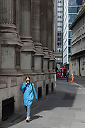 Woman wearing an animal face mask in the City of London, which is eerily quiet and silent and empty as lockdown continues and people observe the stay at home message in the capital on 11th May 2020 in London, England, United Kingdom. Coronavirus or Covid-19 is a new respiratory illness that has not previously been seen in humans. While much or Europe has been placed into lockdown, the UK government has now announced a slight relaxation of the stringent rules as part of their long term strategy, and in particular social distancing.