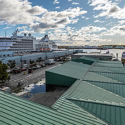 The Maine State Ferry (right) makes it's way into its dock in Portland, Maine.