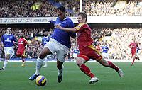 Photo: Paul Thomas.<br /> Everton v Reading. The Barclays Premiership. 14/01/2007.<br /> <br /> Joleon Lescott (L) of Everton battles with Kevin Doyle.
