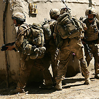 29/06/07..Sangin Valley, Helmand, Afghanistan..Soldiers from A Company 1 Battalion Royal Anglians, known as 'The Vikings' prepare to enter a compound whilst conducting operations against the Taliban in the Sangin Valley, Helmand province, Afghanistan on the 29th June 2007...The soldiers made a Tactical Advance to Battle over night carrying just food, water and ammunition. At first light they moved on their objectives; a series of compounds, orchards and paddy fields. During the day they exchanged fire with the enemy on a number of occasions. 13 Taliban were killed, 1 British soldier and 3 Afghan troops were wounded.....