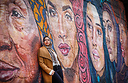 """UIC College of Engineering 2019 CS graduate Sarah Ather poses for a photo in Chicago<br /> """"Weaving Cultures"""" mural by Sam Kirk @iamsamkirk."""