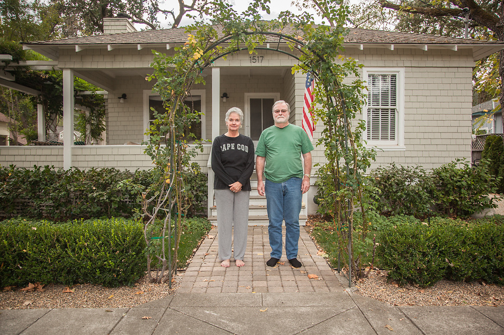 """""""When I bought this house in 1989, my twelve year old son explained: ' I can't believe you bought this dump!'  Now, he can't wait for me to die.""""  -Retired Architect Tim Wilkes with his wife, Leslie, in front of their 115 year old home on Cedar Street in Calistoga.  timothy.wilkes@gmail.com"""