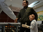 WUHAN, CHINA - NOVEMBER 16: (CHINA OUT) <br /> <br /> 3D-Printed Hand Completed<br /> <br /> A child wears 3D-printed hand with his father shaking hands with a doctor for thanks at Wuhan Third Hospital on November 16, 2015 in Wuhan, Hubei Province of China. A child, a farmer Liu Tao\'s son, fell into a fiery pit where straws was burning when he was only three years old. Left ear and left hand got injured heavily that the left hand had to be cut. While a phone in May this year from Wuhan Third Hospital gave them hope that the lost left hand could be replaced by 3D-printed hand and luckily it made success on the child finally. <br /> ©Exclusivepix Media