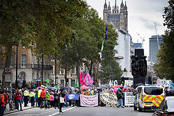 © Licensed to London News Pictures. 07/10/2019. London, UK. Extinction Rebellion activists blockade Whitehall near Dwoning Street. Activists are converging on Westminster blockading roads in the area for at least two weeks calling on government departments to 'Tell the Truth' about what they are doing to tackle the Emergency. Photo credit: Peter Macdiarmid/LNP
