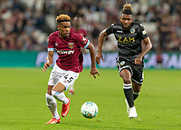 Football - 2018 / 2019 EFL Carabao Cup (League Cup) - Third Round: West Ham United vs. Macclesfield Town<br /> <br /> Grady Diangana (West Ham United) and Tyrone Marsh (Macclesfield Town) in a race for the ball at The London Stadium<br /> <br /> COLORSPORT/DANIEL BEARHAM