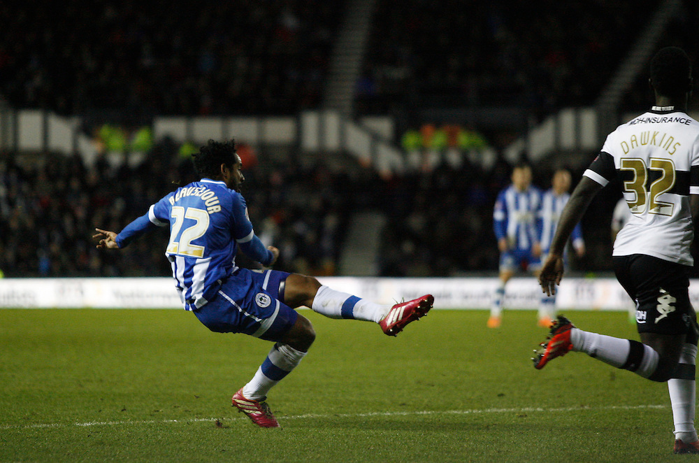 Wigan Athletic's Jean Beausejour scores his sides first goal  <br /> <br /> Photo by Jack Phillips/CameraSport<br /> <br /> Football - The Football League Sky Bet Championship - Derby County v Wigan Athletic - Wednesday 1st January 2014 - The iPro Stadium - Pride Park - Derby <br /> <br /> <br /> <br /> © CameraSport - 43 Linden Ave. Countesthorpe. Leicester. England. LE8 5PG - Tel: +44 (0) 116 277 4147 - admin@camerasport.com - www.camerasport.com