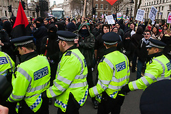 Whitehall, London, April 4th 2015. As PEGIDA UK holds a poorly attended rally on Whitehall, scores of police are called in to contain counter protesters from various London anti-fascist movements. PICTURED: Police officers block anti-fascist protesters from reaching the tiny PEGIDA rally.