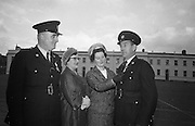 Scott Medals presented. Mrs. tony Barrett admires the Scott Medal presemted to her husband Garda Barrett of Rathmore, watched by Garda Patrick Farrell of Clonmel who also recieved a Scott medal and Mrs. Farrell..21.10.1966