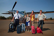 "Horato Clare, Rebecca Shooter with the children Robin Tetlow Shooter & Tyler Talmage arrive in the Phinda Game Reserve by air taxi.<br /> <br /> Phinda Private Game Reserve encompasses an impressive 23 000 hectares (56 800 acres) of prime conservation land wilderness in KwaZulu-Natal, South Africa. Showcasing one of the continent's finest game viewing experiences. Phinda is described as ""Seven Worlds of Wonder"", with its seven distinct habitats - a magnificent tapestry of woodland, grassland, wetland and forest, interspersed with mountain ranges, river courses, marshes and pans. Phinda is a wilderness sanctuary where intimate encounters, adventure and rare discoveries can be experienced firsthand."