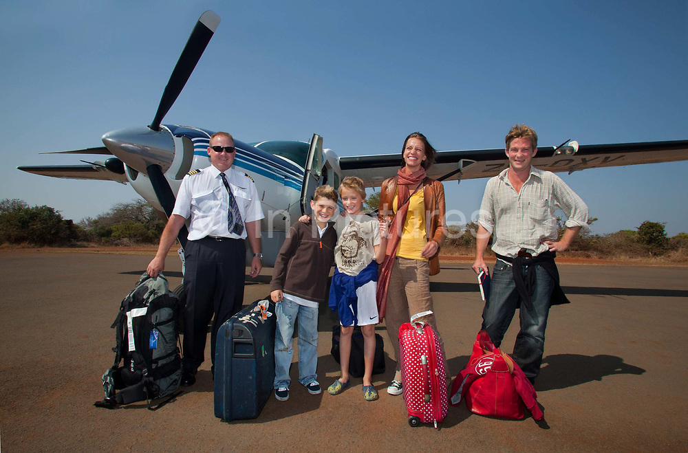"""Horato Clare, Rebecca Shooter with the children Robin Tetlow Shooter & Tyler Talmage arrive in the Phinda Game Reserve by air taxi.<br /> <br /> Phinda Private Game Reserve encompasses an impressive 23 000 hectares (56 800 acres) of prime conservation land wilderness in KwaZulu-Natal, South Africa. Showcasing one of the continent's finest game viewing experiences. Phinda is described as """"Seven Worlds of Wonder"""", with its seven distinct habitats - a magnificent tapestry of woodland, grassland, wetland and forest, interspersed with mountain ranges, river courses, marshes and pans. Phinda is a wilderness sanctuary where intimate encounters, adventure and rare discoveries can be experienced firsthand."""
