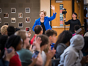 21 OCTOBER 2019 - DES MOINES, IOWA: US Senator ELIZABETH WARREN (D-MA) runs into an assembly for students at Roosevelt High School in Des Moines. Sen. Warren talked to students about her journey from childhood in Oklohoma to running for the US Presidency. Sen. Warren is campaigning to be the Democratic nominee for the US presidency in Iowa this week. Iowa traditionally hosts the the first selection event of the presidential election cycle. The Iowa Caucuses will be on Feb. 3, 2020.                   PHOTO BY JACK KURTZ