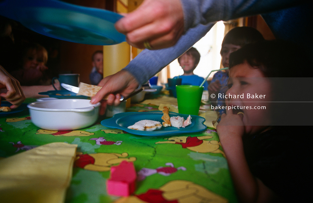 A tots party of friends enjoy snacks and drinks in the lucky birthday girl's family home.