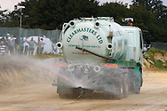 The track is watered to prevent excessive dust being blown onto the nearby M23 during the race meeting at Smallfield Raceway, Surrey, UK on the 10th of July 2011 (photo by Andrew Tobin/SLIK images)
