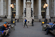 Wet Paint signs and passing Londoners, on 16th February 2017, outside Royal Exchange and the WW1 memorial, in the City of London, England.
