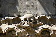 skull ornament, on facade of old building in Pilies street, Vilnius, Lithuania