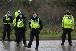 A senior Hertfordshire Police officer invokes Section 14 of the Public Order Act 1986 to clear anti-HS2 activists and press photographers from an area outside an entrance to the Chiltern Tunnel South Portal site for the HS2 high-speed rail link on 9 October 2020 in West Hyde, United Kingdom. The protest action by anti-HS2 activists, at the site from which HS2 Ltd intends to drill a 10-mile tunnel through the Chilterns, was intended to remind Prime Minister Boris Johnson that he committed to remove deforestation from supply chains and to provide legal protection for 30% of UK land for biodiversity by 2030 at the first UN Summit on Biodiversity on 30th September.