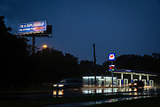 """A billboard reading """"I'M A DEPLORABLE! I'M VOTING FOR TRUMP!"""" is seen above a frontage road next to Interstate 4 in central Florida, U.S., October 3, 2016. The """"I-4 Corridor"""" is a coveted swing region for presidential hopefuls, connecting the cities of Tampa, Orlando and Daytona Beach."""