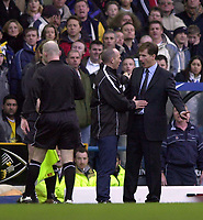 Photo: Greig Cowie<br />Barclaycard Premiership. Leeds United v West Ham United. 08/02/2002<br />Glenn Roeder protests too fourth official Mike Dean as Dermot Gallagher consults with his  linesman over the sending off of Frederic Kanoute