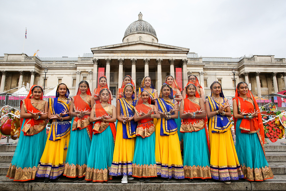 © Licensed to London News Pictures. 03/11/2019. London, UK. Dancers in colourful saris and costumes pose during the Diwali celebrations in London's Trafalgar Square. Hundreds of Hindus, Sikhs, Jains and people from all communities attend Diwali celebrations in London's Trafalgar Square. Diwali s celebrated each year with a free concert of traditional, religious and contemporary Asian music and dance. Photo credit: Dinendra Haria/LNP