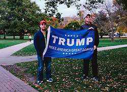 November 11, 2016 - Columbus, Ohio, U.S - Trump supporters look on as an Anti-Trump protest takes place in front of them. Anti-Trump protests have sprung up accross the nation with people vocing and showing their disdain for President Elect-Donald Trump. (Credit Image: © Seth Herald via ZUMA Wire)