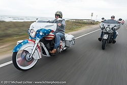 Tim Sutherland (L) of Coastal Indian riding beside Jake Cutler (R) of Barnstorm Cycles on their custom Indian Chieftains beside the Atlantic Ocean during Daytona Beach Bike Week. FL. USA. Monday March 13, 2017. Photography ©2017 Michael Lichter.