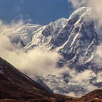 Clouds shrod Annapurna South in Nepal