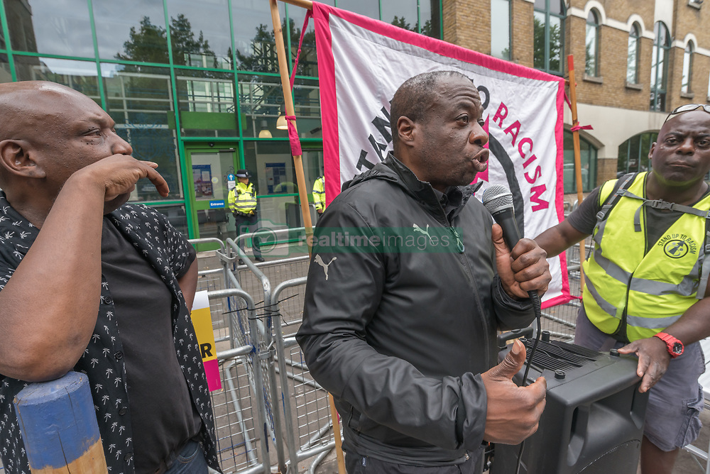 July 29, 2017 - London, UK - London, UK. 29th July 2017. Weyman Bennett of Stand Up to Racism introduces the protst at Stoke Newington Police Station for Rashan Charles, who died when two police handcuffed him and held him on the floor at a shop on the Kingsland Rd in the early hours of Saturday 22nd July. His family are determined to get answers about his death but call for everyone to act within the law. Members of the Charles family came to the protest along with family of Edson da Costa, who died after arrest in East Ham in June. Protesters held pictures the two men and Darren Cumberbatch, who died earlier this month after arrest in Nuneaton. Independent charity Inquest say that Rashan Charles was the 1,619th person to have died in contact with the police since 1990. Peter Marshall ImagesLIve (Credit Image: © Peter Marshall/ImagesLive via ZUMA Wire)