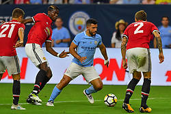 Manchester City forward Sergio Aguero (10) get past Manchester United players during play a the International Champions Cup match between Manchester United and Manchester City at NRG Stadium in Houston, Texas