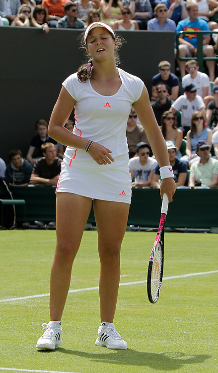 Mcc0038137 . Daily Telegraph..Wimbledon Day 2..Britiain's Laura Robson is knocked out by Francesca Schiavone ,Court 3, on the second day of Wimbledon...26 June 2012