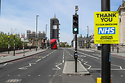 """A poster says """"Thank You NHS"""" in front of St Thomas' Hospital in central London. Office for National Statistics (ONS) confirmed on Tuesday, May 5, 2020, that more people have died in the United Kingdom from coronavirus than any other European country. (Photo/Vudi Xhymshiti)"""