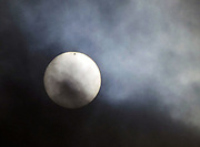 It promised to be a once in a lifetime event, but Venus transiting the sun might best be seen in someone else's lifetime.  Clouds obscured the sun forcing the cancelation of many viewing parties.  Still, for the moments when the clouds parted the spec on the sun that was Venus was visible. (Dean Rutz / The Seattle Times, 2012)