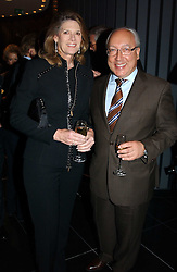 MR & MRS URS SCHWARZENBACH he is the multi millionaire polo patron at a reception and buffet-dinner hosted by H.E.Alexis P.Lautenberg, Ambassador of Switzerland to celebrate British-Swiss friendship and the forthcoming 'UN International Year of Sport and Physical Education 2005' at 40 St.Mary Axe (The Gherkin) London EC3 on 13th December 2004.<br /><br />NON EXCLUSIVE - WORLD RIGHTS