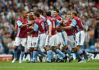 Photo: Rich Eaton.<br /> <br /> Aston Villa v Newcastle United. The Barclays Premiership. 27/08/2006. Luke Moore #22 is congratulated by teammates after scoring Aston Villas opening goal