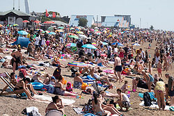 © Licensed to London News Pictures. 31/07/2020. Southend, UK. People head to the beach at Southend-on-Sea as social distancing measures are relaxed and temperatures are expected to be over 30c. British holiday makers have chosen to book staycations in the UK as the uncertainty of Covid-19 lockdown looms. Photo credit: Ray Tang/LNP
