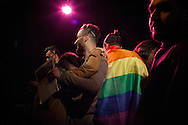 Hussein (centre left) is hugged by friends after being announced as the winner, Mr Gay Syria 2016