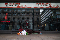 © Licensed to London News Pictures . 25/12/2018 . Manchester , UK . A homeless person sleeping rough outside a tourist shop on Portland Street opposite the Britannia Hotel . Homeless people sleeping rough on the streets of Manchester City Centre on Christmas Day . Photo credit : Joel Goodman/LNP