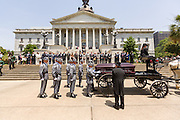Police honor guard removes the casket of slain State Senator Clementa Pinckney from the horse-drawn caisson after arriving at the State House June 24, 2015 in Columbia, South Carolina. Pinckney is one of the nine people killed in last weeks Charleston church massacre.