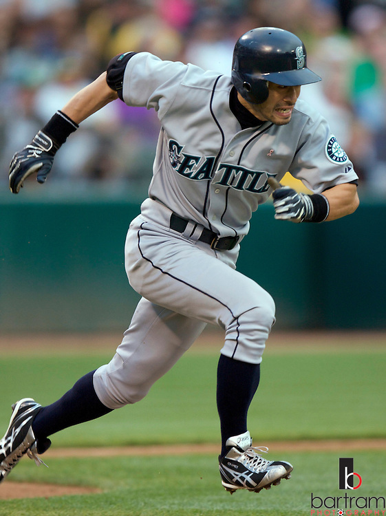 The Seattle Mariners' Ichiro Suzuki runs to first base following a second inning single against  the Oakland Athletics at Oakland-Alameda County Coliseum.  REUTERS/Kevin Bartram