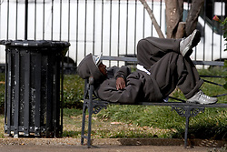 16 December, 05. New Orleans, Louisiana. Post Katrina aftermath.<br />  A town full of people who no longer have homes. A homeless man finds time to take a nap on a park bench in Jackson Square, New Orleans.<br /> Photo; ©Charlie Varley/varleypix.com