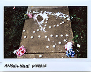 Melted candles lay on the ground in memory of Angelique Morris, 17-year-old, in the 10400 block of Michael Todd Terrace in Glenview, Illinois, in this photo taken July 10, 2017. Morris died from a gunshot wound to the head in the 9900 block of Linda Lane in Des Plaines, Illinois on July 8, 2017. A 17-year-old boy has been charged with involuntary manslaughter for the fatal shooting.