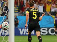 Jan Vertonghen of Belgium runs off to celebrate after scoring to make it 0-1