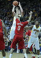 January 26, 2012: Iowa Hawkeyes forward Zach McCabe (15) puts up a shot over Nebraska Cornhuskers guard Toney McCray (0) during the NCAA basketball game between the Nebraska Cornhuskers and the Iowa Hawkeyes at Carver-Hawkeye Arena in Iowa City, Iowa on Thursday, January 26, 2012.