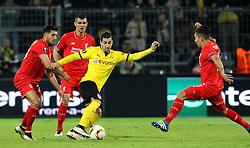 Henrikh Mkhitaryan of Borussia Dortmund takes Roberto Firmino, Emre Can and Dejan Lovren of Liverpool - Mandatory by-line: Robbie Stephenson/JMP - 07/04/2016 - FOOTBALL - Signal Iduna Park - Dortmund,  - Borussia Dortmund v Liverpool - UEFA Europa League Quarter Finals First Leg
