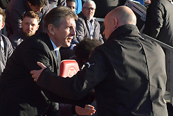 Leicester City manager Claude Puel (left) and Fleetwood Town manager Uwe Rosler shake hands before the game