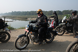 Rip Rolfsen along the East Rapti River in Chitwan National Park for our Himalayan Heroes adventure day-3 ride from Chitwan to Pokhara, Nepal. Thursday, November 8, 2018. Photography ©2018 Michael Lichter.